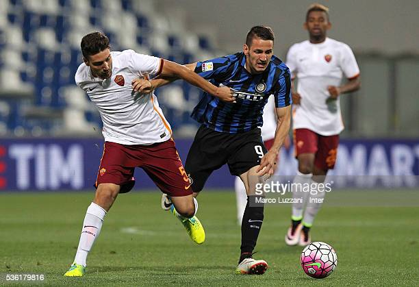 Rey Manaj of FC Internazionale competes for the ball with Riccardo Marchizza of AS Roma during the juvenile playoff match between FC Internazionale...