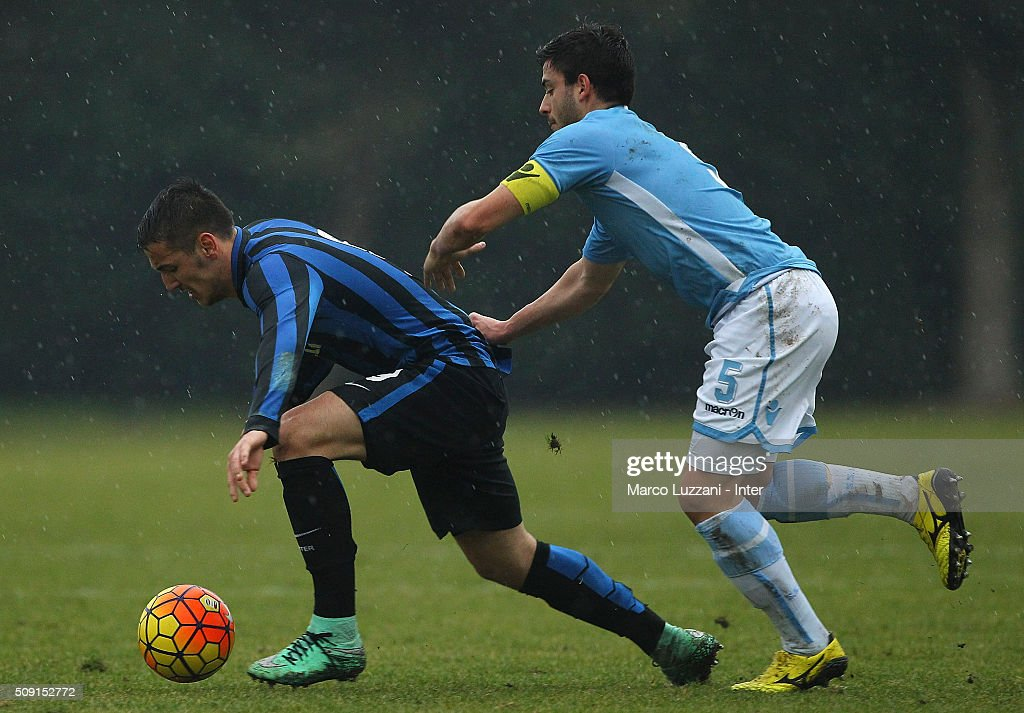 Rey Manaj of FC Internazionale Milano competes for the ball with Simone Mattia of SS Lazio during the juvenile TIM cup match between FC Internazionale and SS Lazio at Stadio Breda on February 9, 2016 in Sesto San Giovanni, Italy.