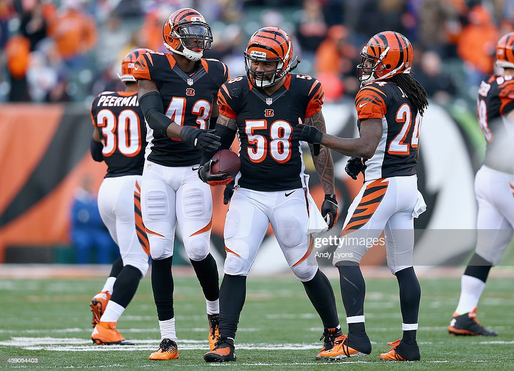 <a gi-track='captionPersonalityLinkClicked' href=/galleries/search?phrase=Rey+Maualuga&family=editorial&specificpeople=2130661 ng-click='$event.stopPropagation()'>Rey Maualuga</a> #58 of the Cincinnati Bengals celebrates with <a gi-track='captionPersonalityLinkClicked' href=/galleries/search?phrase=George+Iloka&family=editorial&specificpeople=5571232 ng-click='$event.stopPropagation()'>George Iloka</a> #43 and Adam Jones #24 after intercepting a pass during the NFL game against the Minnesota Vikings at Paul Brown Stadium on December 22, 2013 in Cincinnati, Ohio.