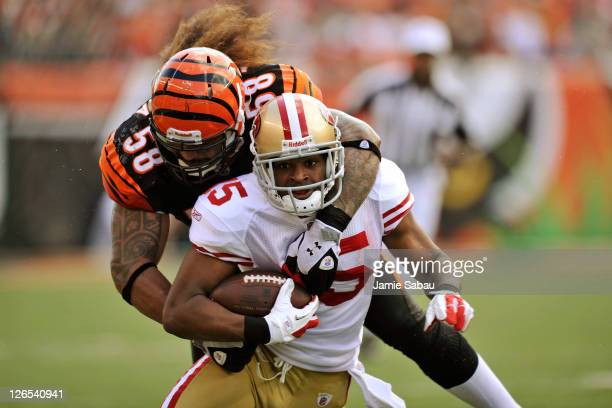 Rey Maualuga of the Cincinnati Bengals tackles Michael Crabtree of the San Francisco 49ers after Crabtree made a pass reception at Paul Brown Stadium...