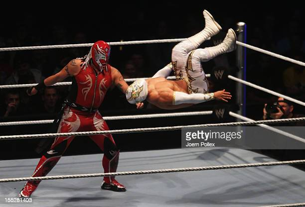 Rey Mysterio competes in the ring against Sin Cara during the WWE SmackDown World Tour at O2 World on November 2 2012 in Hamburg Germany