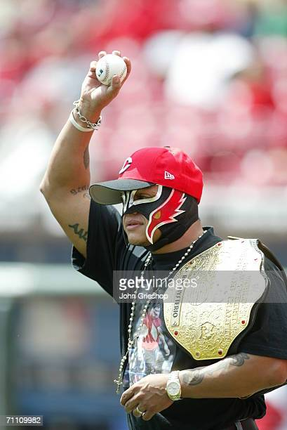 Rey Mysterio of the WWE throws out the first pitch prior to the game between the Cincinnati Reds and the St Louis Cardinals at Great American Ball...