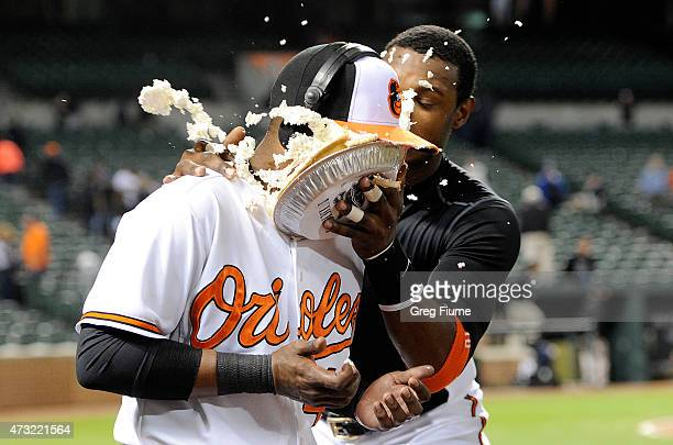 Rey Navarro of the Baltimore Orioles is hit with a pie by Adam Jones after a 61 victory over the Toronto Blue Jays at Oriole Park at Camden Yards on...