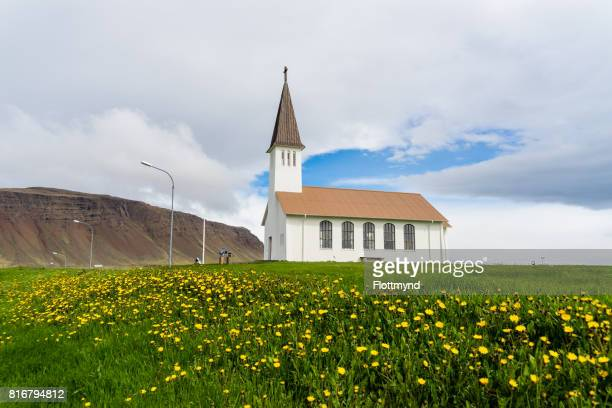 Reykholakirkja, surrounded by flowers in Reykholar, Iceland