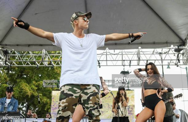 Reykon performs on stgae during the iHeartLatino TU949FM Calle Ocho festival on March 12 2017 in Miami Florida