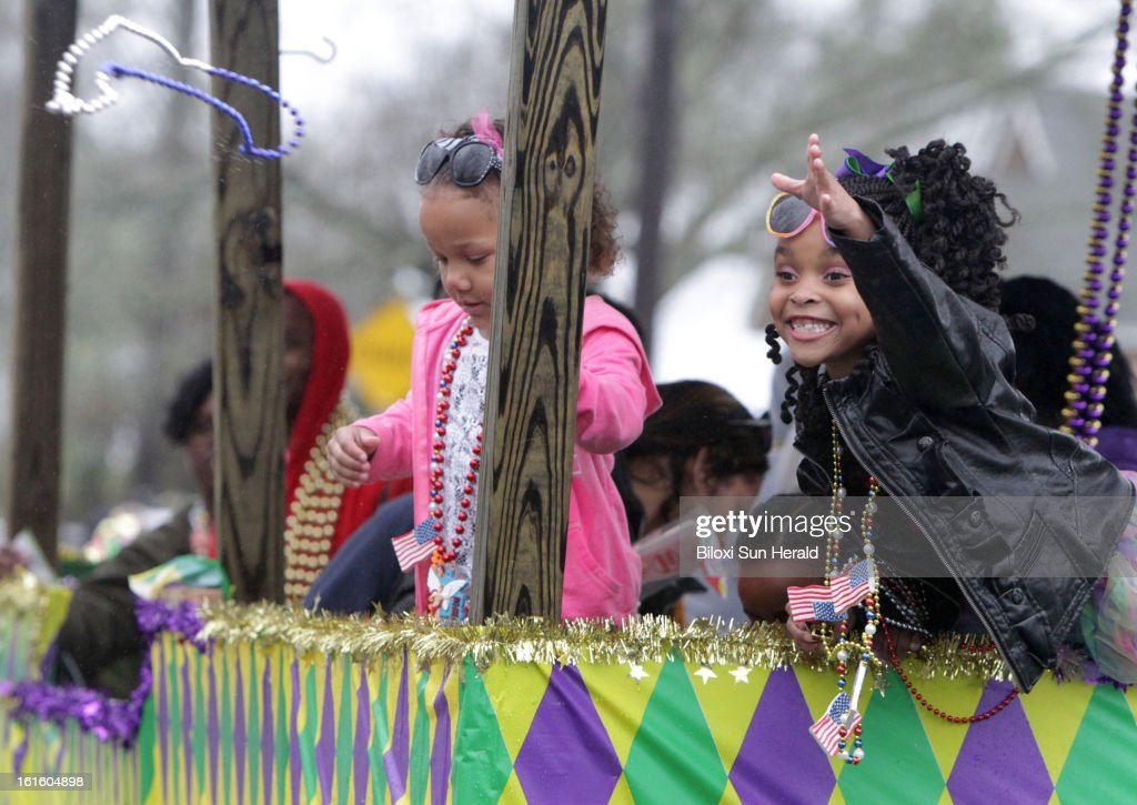 Reylin Lewis, 7, of Pass Christian, Mississippi, tosses beads to a friend during the Krewe of Diamonds Mardi Gras parade in Bay St. Louis, Mississippi, Tuesday, February 12, 2013. Four parades rolled in South Mississippi on Fat Tuesday despite rainy weather.