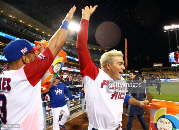 Reymond Fuentes and Kike Hernandez of Team Puerto Rico celebrate after Game 1 of the Championship Round of the 2017 World Baseball Classic against...
