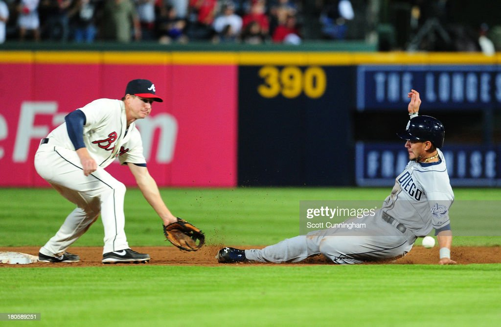 Reymond Fuentes #27 of the San Diego Padres steals second base against Elliot Johnson #30 of the Atlanta Braves at Turner Field on September 14, 2013 in Atlanta, Georgia.