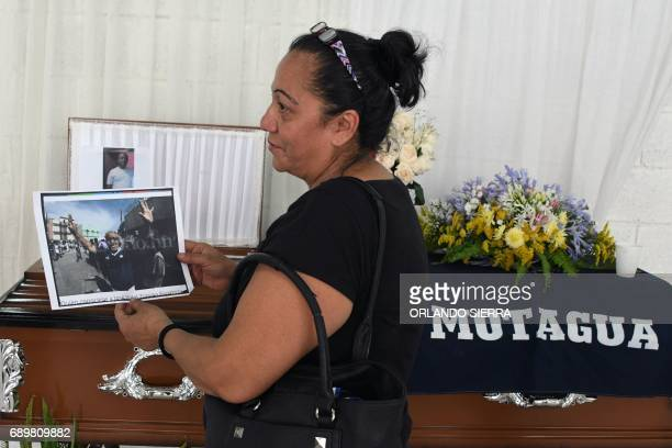 Reyna Funez holds a picture of her husband Jose Vidal Zuniga Espinoza one of the four victims of a human stampede which took place during the...