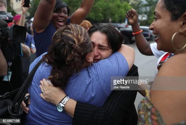Reyna Gomez an undocumented domestic worker from Honduras is hugged after leaving her scheduled check in with ICE at their field office on July 31...