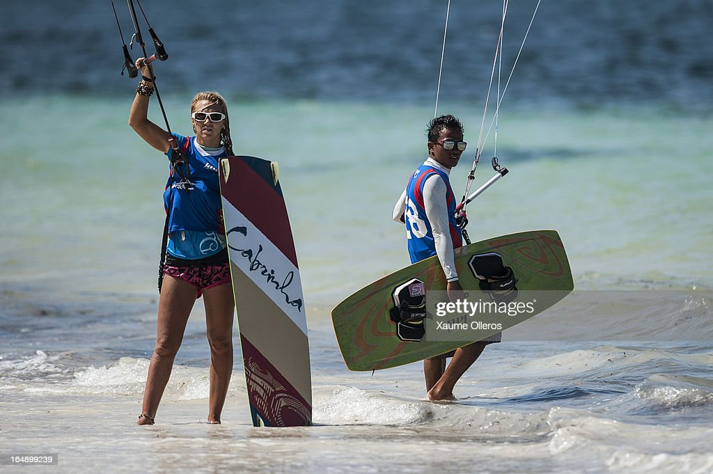 Reynard Gajisan of Philippines (R) and Rebecka Maudal of Norway (L) look on during day four of the KTA at Boracay Island on March 29, 2013 in Makati, Philippines.