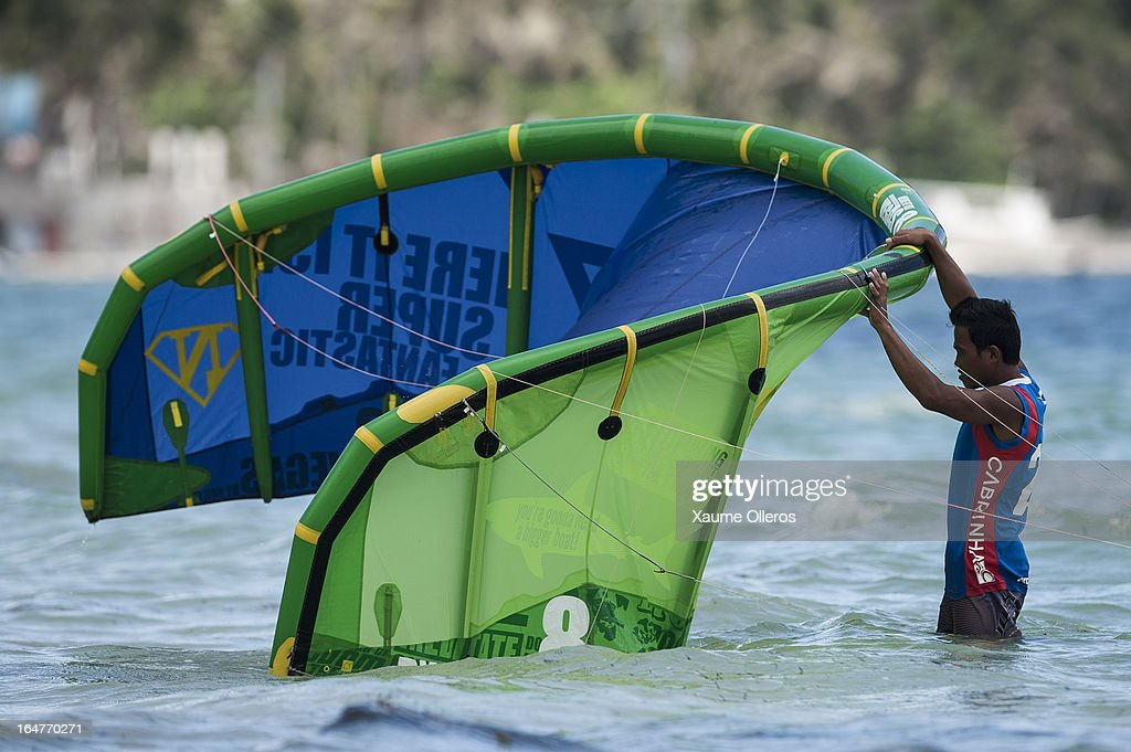 Reynard Gasijan of Philippines sets up a kite during day two of the KTA at Boracay Island on March 27, 2013 in Makati, Philippines.
