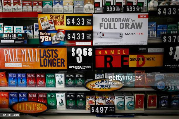 Reynolds American Inc brand Pall Mall bottom left and Camel cigarettes bottom right are displayed for sale at a B N Food Market convenience store in...