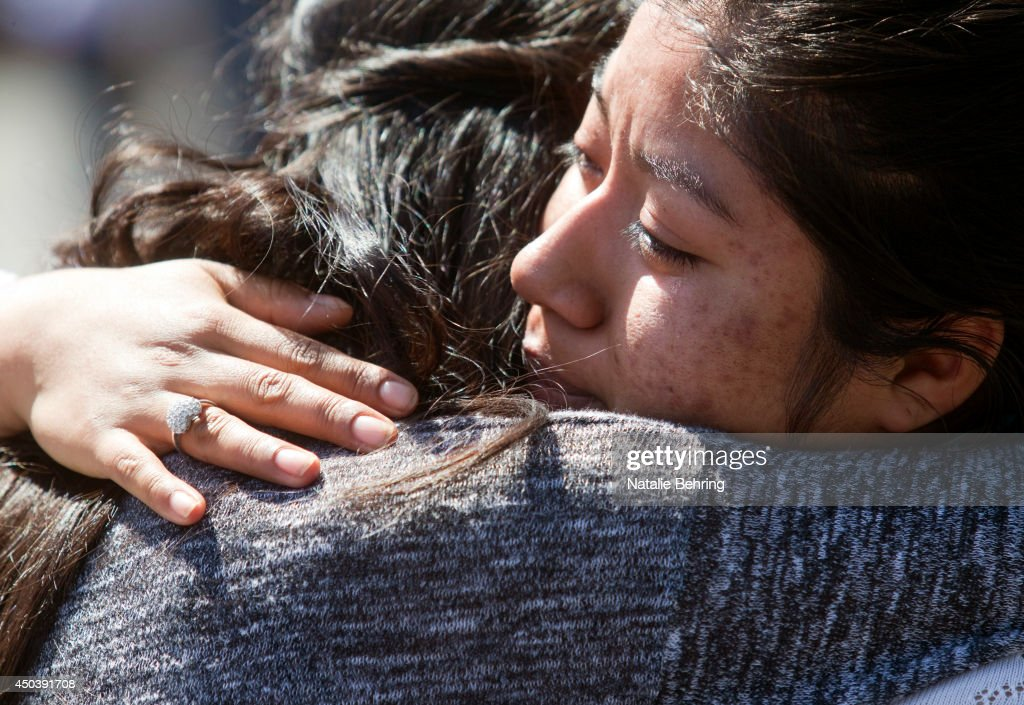A Reynolds High School student is reunited with her mother after a shooting at her school June 10, 2014 in Troutdale, Oregon. Authorities said one student was fatally shot and the gunman was found dead at an Oregon high school.
