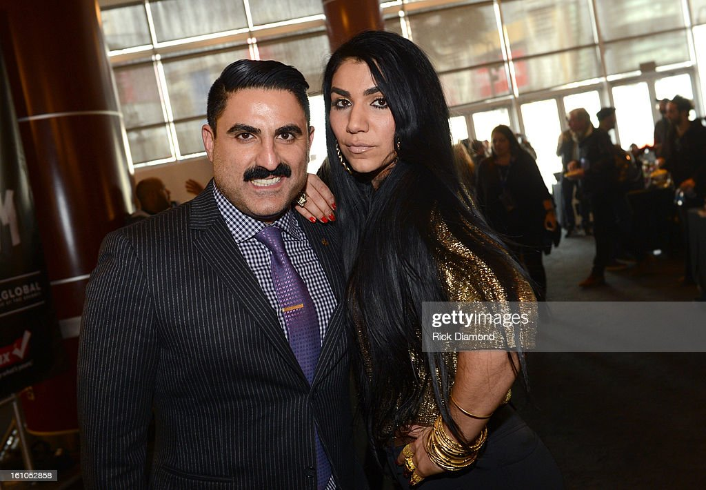 Reza Farahan (L) and Asa Soltan Rahmati pose backstage at the GRAMMYs Dial Global Radio Remotes during The 55th Annual GRAMMY Awards at the STAPLES Center on February 8, 2013 in Los Angeles, California.