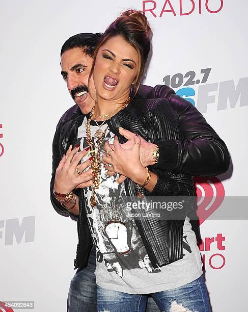 Reza Farahan and Golnesa 'GG' Gharachedaghi attend KIIS FM's Jingle Ball at Staples Center on December 6 2013 in Los Angeles California