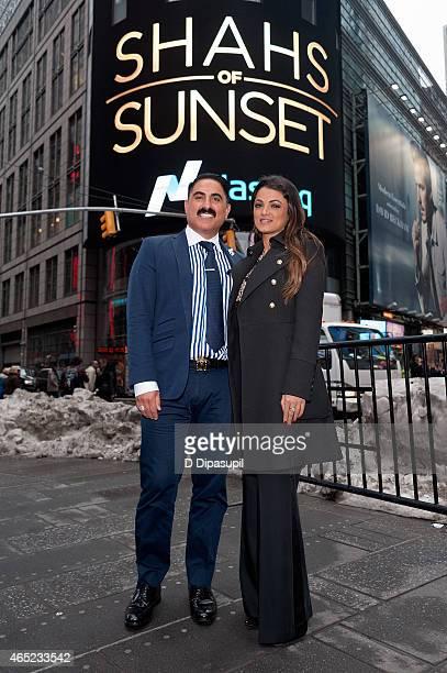 Reza Farahan and Golnesa 'GG' Gharachedaghi of the 'Shahs of Sunset' ring the NASDAQ Closing Bell at NASDAQ MarketSite on March 4 2015 in New York...