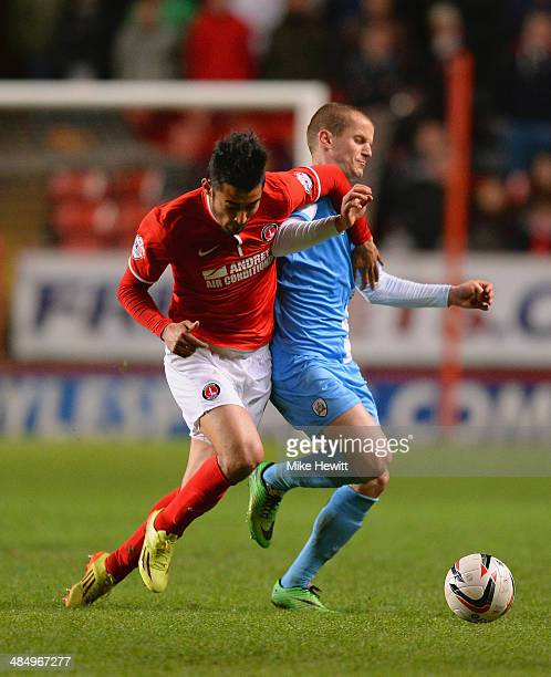 Reza Ghoochannejhad of Charlton and Tomasz Cywka of Barnsley compete for the ball during the Sky Bet Championship match between Charlton Athletic and...
