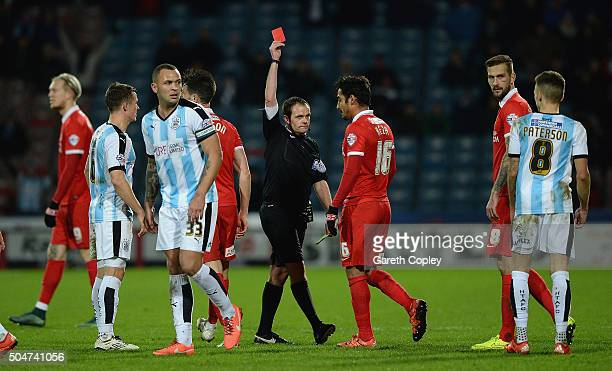 Reza Ghoochannejhad of Charlton Athletic is sent off by referee Geoff Eltringham during the Sky Bet Championship match between Huddersfield Town and...