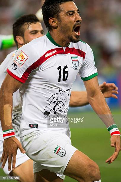Reza Ghoochannejhad of Iran celebrate his goal with teammates during the 2015 Asian Cup match between IR Iran and the UAE at Suncorp Stadium on...