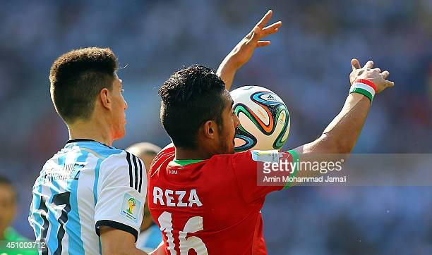 Reza Ghoochannejhad of Iran in action against Federico Fernandez of Argentina during the 2014 FIFA World Cup Brazil Group F match between Argentina...
