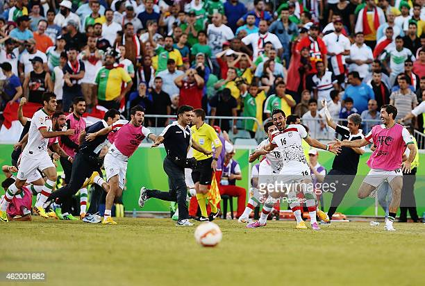 Reza Ghoochannejhad of Iran reacts after scoring the goal to take the match to a penalty shoot out during the 2015 Asian Cup match between Iran and...