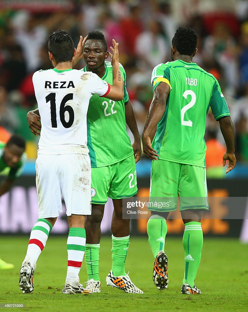 <a gi-track='captionPersonalityLinkClicked' href=/galleries/search?phrase=Reza+Ghoochannejhad&family=editorial&specificpeople=9861610 ng-click='$event.stopPropagation()'>Reza Ghoochannejhad</a> of Iran reacts with <a gi-track='captionPersonalityLinkClicked' href=/galleries/search?phrase=Kenneth+Omeruo&family=editorial&specificpeople=6392838 ng-click='$event.stopPropagation()'>Kenneth Omeruo</a> of Nigeria after their draw during the 2014 FIFA World Cup Brazil Group F match between Iran and Nigeria at Arena da Baixada on June 16, 2014 in Curitiba, Brazil.