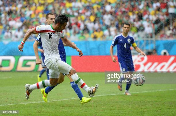 Reza Ghoochannejhad of Iran shoots and scores his team's first goal during the 2014 FIFA World Cup Brazil Group F match between Bosnia and...