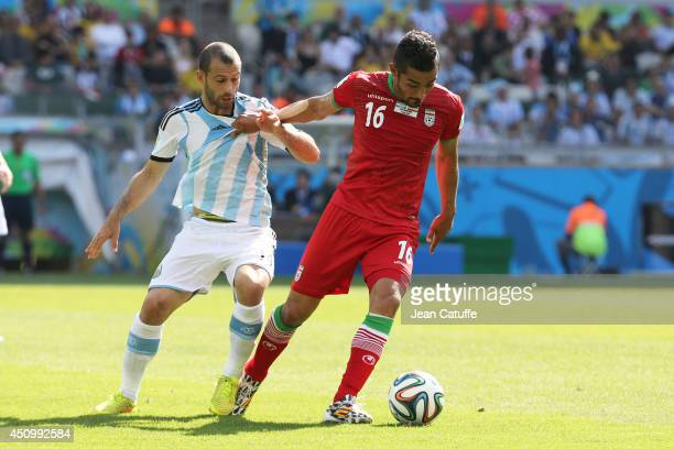 Reza Ghoochannejhad of Iran under pressure of Javier Mascherano of Argentina during the 2014 FIFA World Cup Brazil Group F match between Argentina...