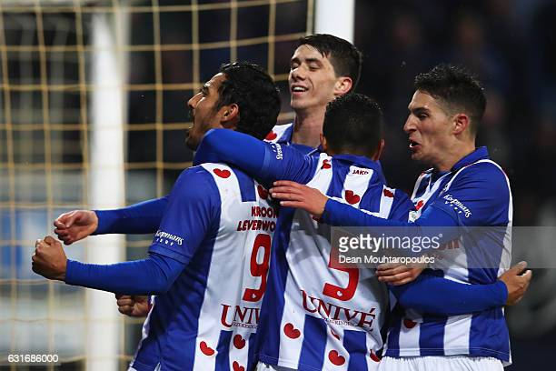 Reza Ghoochannejhad of sc Heerenveen celebrates scoring his teams first goal of the game with team mates during the Dutch Eredivisie match between SC...