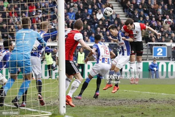 Reza Ghoochannejhad of sc Heerenveen goalkeeper Erwin Mulder of sc Heerenveen Joost van Aken of sc Heerenveen JanArie van der Heijden of Feyenoord...
