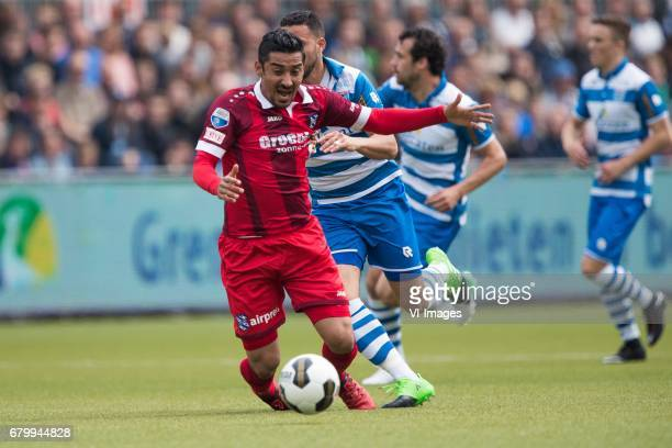 Reza Ghoochannejhad of sc Heerenveen Ouasim Bouy of PEC Zwolleduring the Dutch Eredivisie match between PEC Zwolle and sc Heerenveen at the MAC3Park...