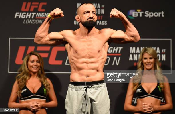 Reza Madadi of Iran poses on the scale during the UFC Fight Night weighin at The O2 arena on March 17 2017 in London England