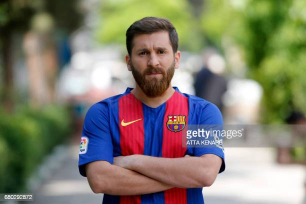 Reza Parastesh a doppelganger of Barcelona and Argentina's footballer Lionel Messi poses for a picture in a street in Tehran on May 8 2017 / AFP...