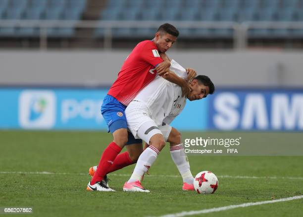 Reza Shekari of Iran battles with Diego Mesen of Costa Rica during the FIFA U20 World Cup Korea Republic 2017 group C match between Iran and Costa...