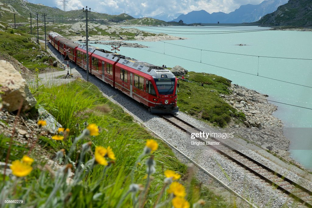 RHB, Rhaetian Railway, along the Lago Bianco (2234m) on the Unesco World heritage route in Grisons, Engadin, Switzerland.