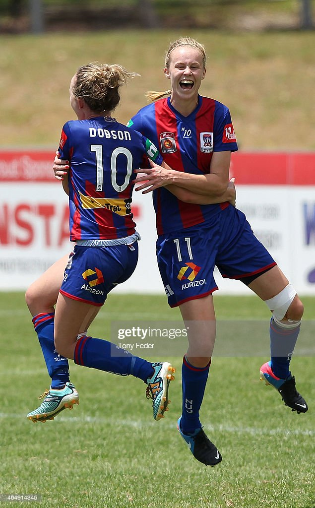 Rhali Dobson and Grace Macintyre of the Jets celebrate a goal during the round 10 W-League match between the Newcastle Jets and Melbourne Victory at Adamstown Oval on January 25, 2014 in Newcastle, Australia.