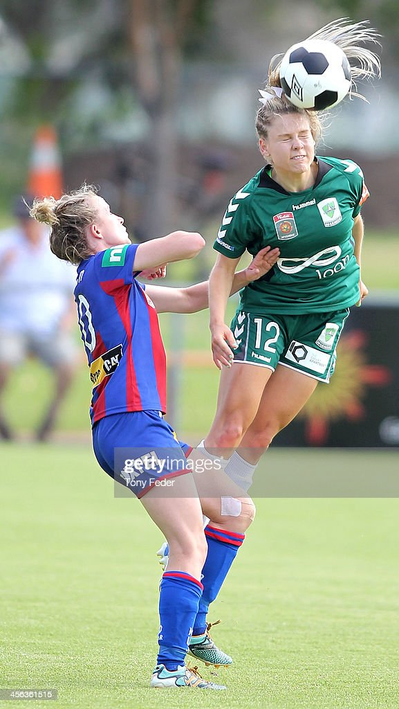 Rhali Dobson of the Jets contests the header against Sally Rojahn of Canberra United during the round five W-League match between the Newcastle Jets and Canberra United at Wanderers Oval on December 14, 2013 in Newcastle, Australia.