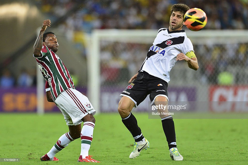 Rhayner (L) of Fluminense in action during a match between Fluminense and Vasco as part of Brazilian Championship 2013 at Maracana Stadium on July 21, 2013 in Rio de Janeiro, Brazil.