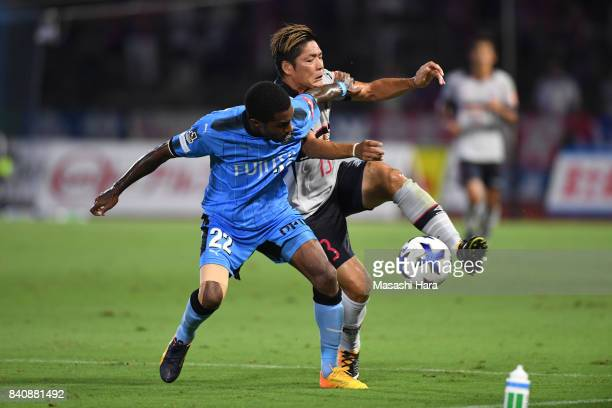 Rhayner of Kawasaki Frontale and Yoshito Okubo of FC Tokyo and compete for the ball during the JLeague Levain Cup quarter final first leg match...