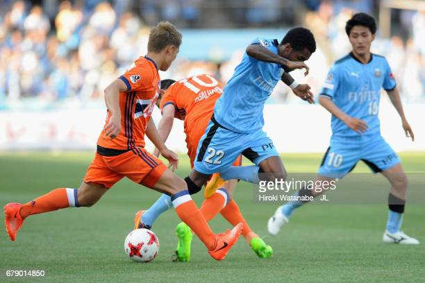 Rhayner of Kawasaki Frontale competes for the ball against Thiago Galhardo and Kei Koizumi of Albirex Niigata during the JLeague J1 match between...