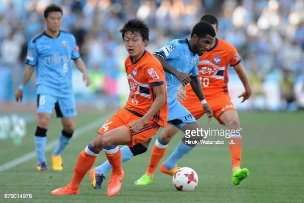Rhayner of Kawasaki Frontale competes for the ball against Thiago Galhardo and Teruki Hara of Albirex Niigata during the JLeague J1 match between...