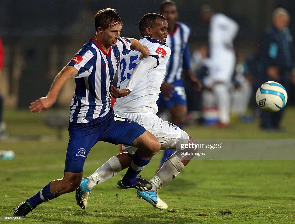 Rheece Evans of Maritzburg Utd holds off Omar Zane Hendricks of MP Black Aces during the Absa Premiership match between Maritzburg United and MP Black Aces at Harry Gwala Stadium on September 18, 2013 in Durban, South Africa.