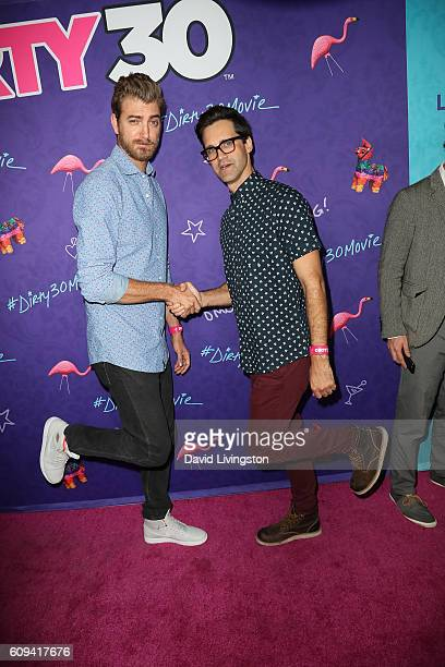 Rhett and Link arrive at the Premiere of Lionsgate's 'Dirty 30' at the ArcLight Hollywood on September 20 2016 in Hollywood California