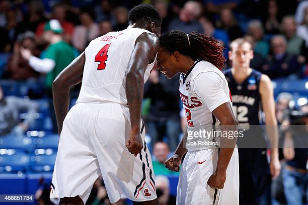 J Rhett celebrates with Stefan Moody of the Mississippi Rebels against the Brigham Young Cougars during the first round of the 2015 NCAA Men's...