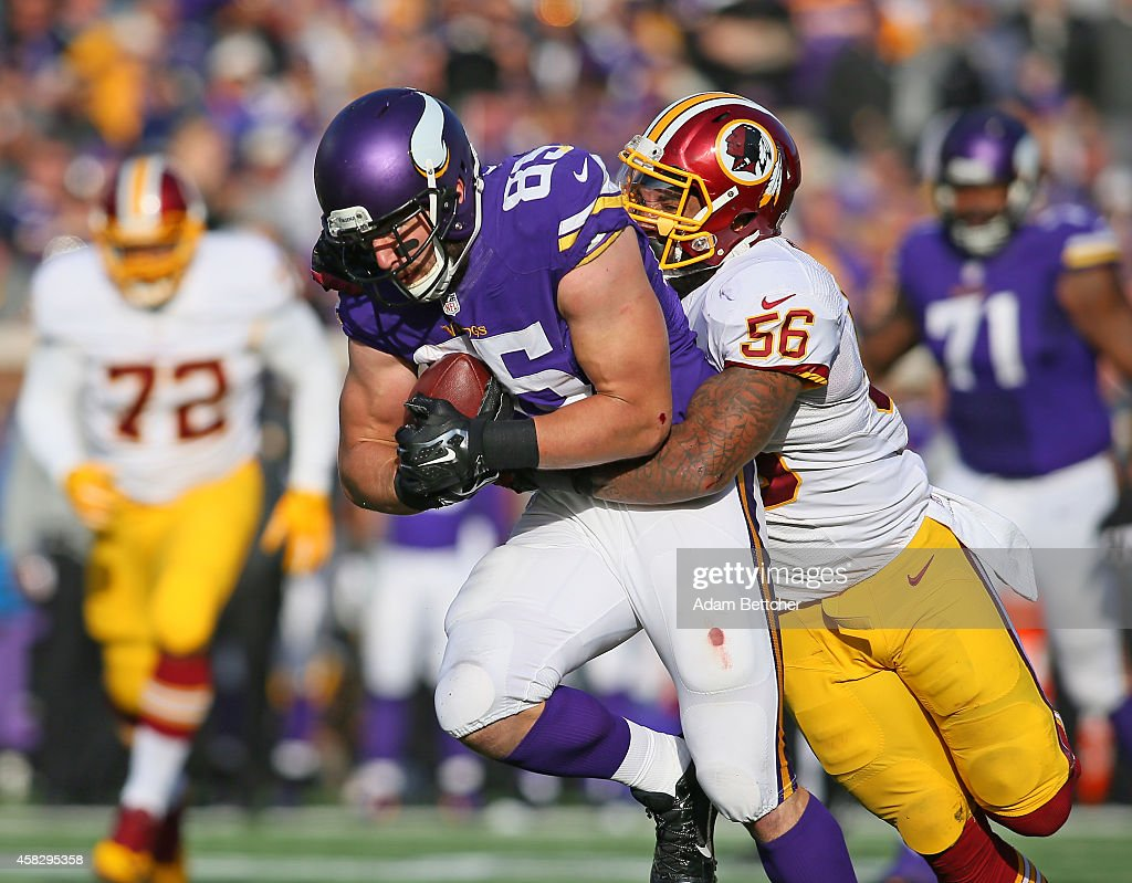 Rhett Ellison of the Minnesota Vikings carries the ball while being tackled by Perry Riley of the Washington Redskins during the third quarter on...