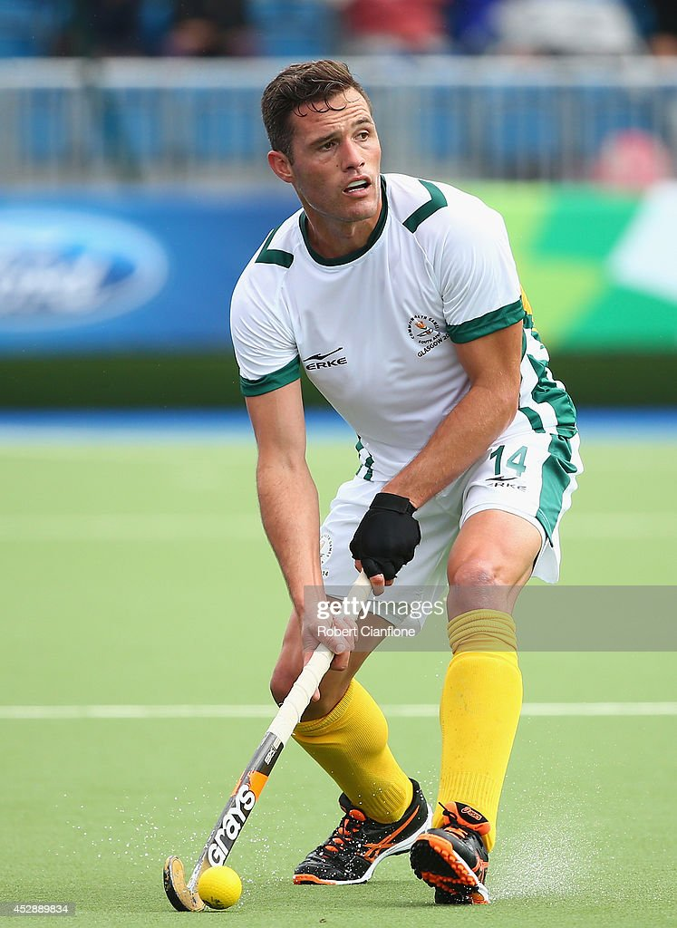 Rhett Hackett of South Africa looks to pass the ball during the men's preliminaries match between Wales and South Africa at the Glasgow National Hockey Centre during day six of the Glasgow 2014 Commonwealth Games on July 29, 2014 in Glasgow, United Kingdom.