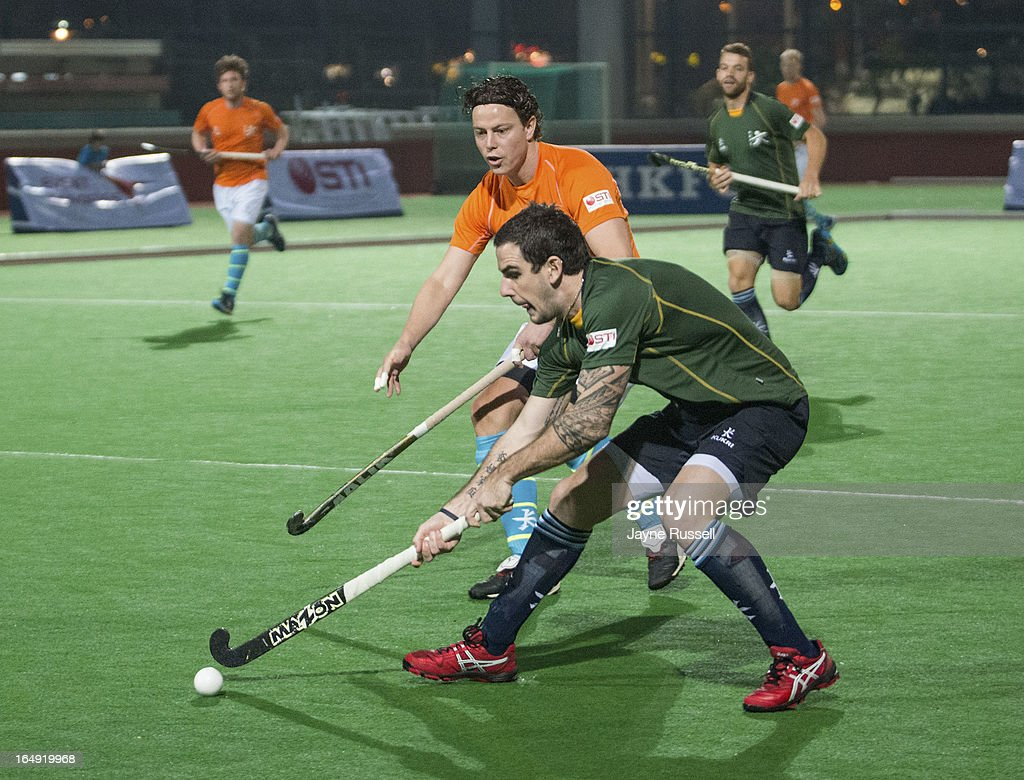 Rhett Halket #5 of the Earth Team (Australia) (R) runs the ball away from Geert Jan Derikx #10 (Back L) of the Air Team (Holland) on the first staging of a Hockey 5's International in Hong Kong- Day Two of the 2013 Hong Kong 6's at Hong Kong Football Club on March 29, 2013 in Hong Kong, Hong Kong.