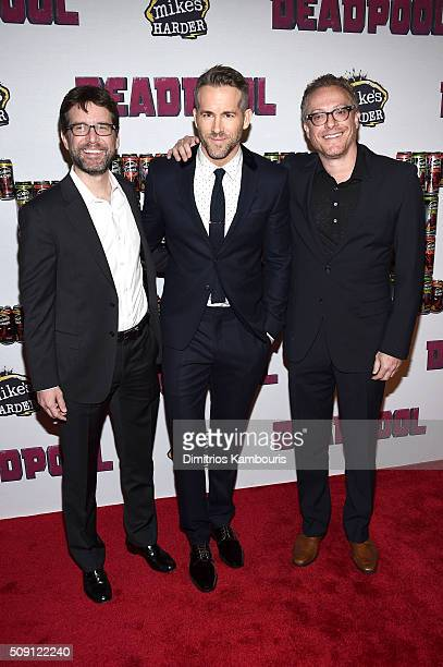 Rhett Reese Ryan Reynolds and Paul Wernick attend the 'Deadpool' fan event at AMC Empire Theatre on February 8 2016 in New York City