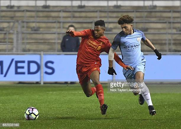 Rhian Brewster of Liverpool and Jadon Sancho of Manchester City in action during the Manchester City v Liverpool FA Youth Cup game at Etihad Campus...